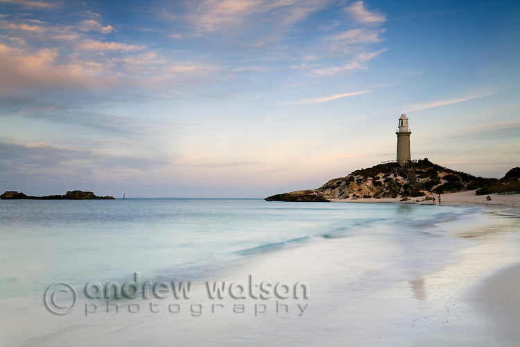 View along Pinky Beach to Bathurst lighthouse at dusk.  Rottnest Island, Western Australia, AUSTRALIA.