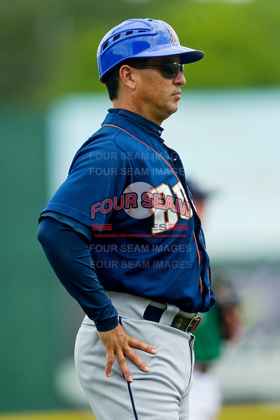 Durham Bulls manager Charlie Montoyo (25) coaches third base during the International League game against the Charlotte Knights at Knights Stadium on August 18, 2013 in Fort Mill, South Carolina.  The Bulls defeated the Knights 8-5 in Game One of a double-header.  (Brian Westerholt/Four Seam Images)