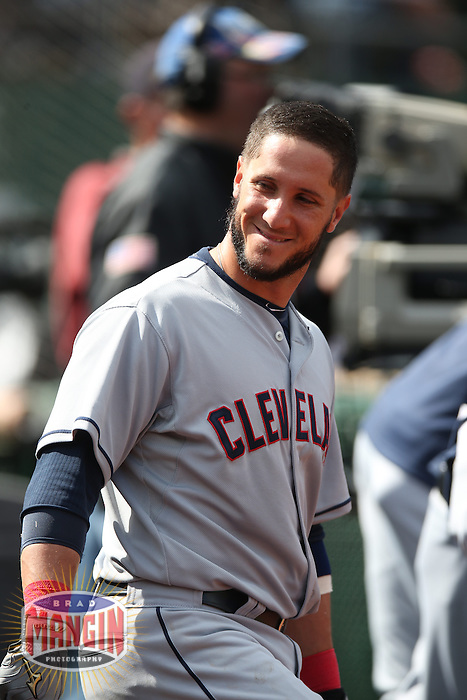 OAKLAND, CA - APRIL 2:  Yan Gomes #10 of the Cleveland Indians smiles in the dugout against the Oakland Athletics during the game at O.co Coliseum on Wednesday, April 2, 2014 in Oakland, California. Photo by Brad Mangin