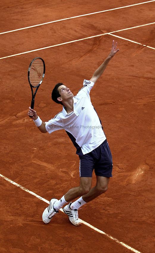 Photo. Richard Lane. .Roland Garros 2002, French Open Tennis. 28/5/2002.Tim Henman serves.