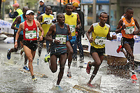 A Peruvian athlete runs beside Kenyan athletes in the men's category, during the 32nd Mexico City International Marathon held in Mexico City, capital of Mexico, on Aug. 31, 2014. The Mexico City Marathon is a Boston Marathon qualifier. Photo by Miguel Angel Pantaleon/VIEWpress