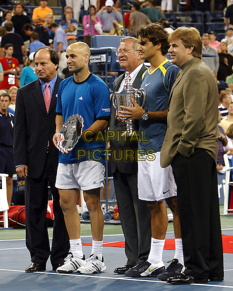 ANDRE AGASSI & ROGER FEDERER .Atmosphere before 2005 US Open Tennis Men's Championship starts, Flushing, NY. .September 11th, 2005.Photo Credit Jackson Lee/Admedia.full length blue shirt trophy award  .www.capitalpictures.com.sales@capitalpictures.com.© Capital Pictures.