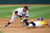 Texas A&M Aggies shortstop Mikey Reynolds (16) tags out LSU Tigers baserunner Andrew Stevenson (6) in the NCAA Southeastern Conference baseball game on May 11, 2013 at Blue Bell Park in College Station, Texas. LSU defeated Texas A&M 2-1 in extra innings to capture the SEC West Championship. (Andrew Woolley/Four Seam Images).