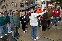 12 March 2006 - Kearny, NJ - Participants in a bus tour of locations featured in the hit television mob show The Sopranos listens to the tour guide Marc Baron (C, gesturing) talk about a scene in Kearny, USA, 12 March 2006.