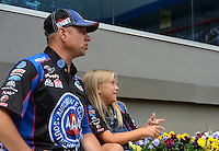 Apr. 15, 2012; Concord, NC, USA: NHRA funny car driver Robert Hight with daughter Autumn Hight during the Four Wide Nationals at zMax Dragway. Mandatory Credit: Mark J. Rebilas-