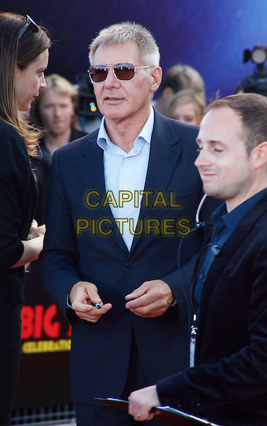 HARRISON FORD.UK Premiere of 'Cowboys and Aliens' at the Cineworld cinema at the O2 Arena, London, England..August 11th 2011.half length blue suit shirt sunglasses shades .CAP/ROS.©Steve Ross/Capital Pictures