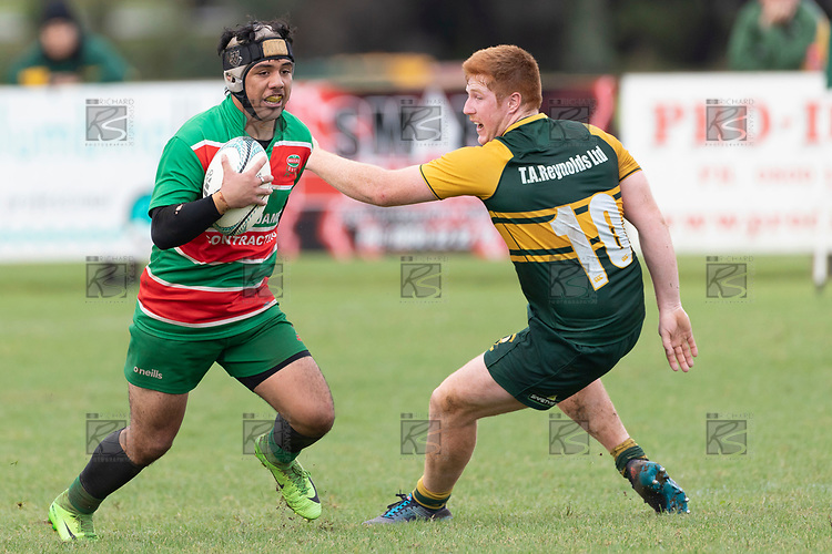 Kalapu Palelei evades Cody White as he attacks during the Counties Manukau Premier Club rugby game between Pukekohe and Waiuku, played at Colin Lawrie Fields, Pukekohe on Saturday April 14th, 2018. Pukekohe won the game 35 - 19 after leading 9 - 7 at halftime.<br /> Pukekohe Mitre 10 Mega -Joshua Baverstock, Sione Fifita 3 tries, Cody White 3 conversions, Cody White 3 penalties.<br /> Waiuku Brian James Contracting - Lemeki Tulele, Nathan Millar, Tevta Halafihi tries,  Christian Walker 2 conversions.<br /> Photo by Richard Spranger