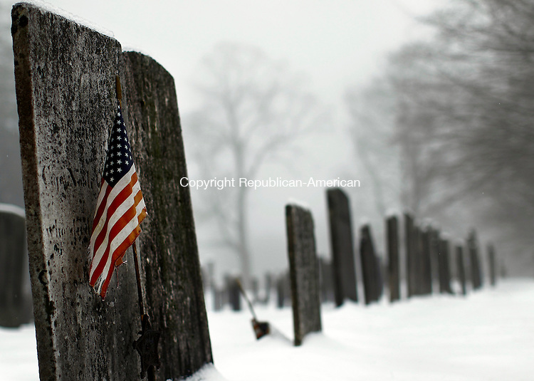 Northfield, CT- 05 January 2015-010415CM01- An American flag stands out against a foggy Northfield Cemetery in Northfield on Sunday morning.  According to the National Weather Service,  Monday is expected to be mostly sunny with a high near 28F.  Christopher Massa Republican-American