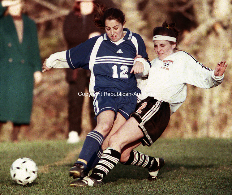 WATERTOWN,CT. 11/9/98--1109SV03.tif--#12 Denise Mancuso of Brookfield and #2 Tina Adams of Watertown battle for the ball during a CIAC soccer match up in Watertown on Monday. Steven Valenti Photo for Sports story.