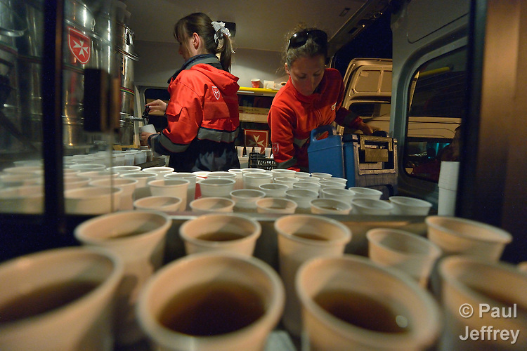 Hungarian volunteers with Malteser International, a Catholic organization, prepare coffee to give to migrants and refugees as they pass through the Hungarian town of Hegyeshalom and prepare to cross the border into Austria. Hundreds of thousands of refugees and migrants flowed through Hungary in 2015, on their way to western Europe from Syria, Iraq and other countries. Malteser International is the relief agency of the Sovereign Order of Malta.