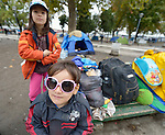 Children pose in a city park in Belgrade, Serbia. The park has filled with refugees from Syria and other countries on their way to western Europe.