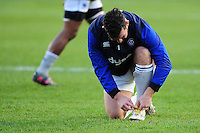 Nathan Catt of Bath Rugby ties his rainbow laces during the pre-match warm-up. Aviva Premiership match, between Harlequins and Bath Rugby on November 27, 2016 at the Twickenham Stoop in London, England. Photo by: Patrick Khachfe / Onside Images