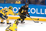 March 26,  2011                      Michigan defenseman Jon Merrill (24) reaches with his stick as Colorado forward Alexander Krushelnyski (16) skates with the puck in the third period. The University of Michigan defeated Colorado College 2-1 in the championship game of the NCAA Division 1 Men's West Regional Hockey Tournament, on Saturday March 26, 2011 at the Scottrade Center in downtown St. Louis.