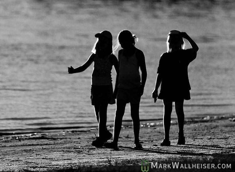 Three best friends comb the beach in the late afternoon of a pretty fall day at Shell Point in Wakulla County Florida.