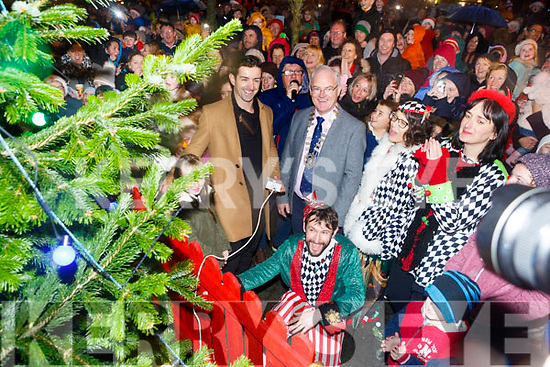Dancing with the Stars and Kerry GAA's  Aidan O'Mahony switches on the Listowel lights with the help of Billy Keane Cllr John Lucid