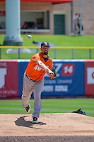 Fresno Grizzlies starting pitcher Mike Hauschild (46) warms up in the bullpen before the game against the Salt Lake Bees in Pacific Coast League action at Smith's Ballpark on June 14, 2015 in Salt Lake City, Utah.  (Stephen Smith/Four Seam Images)