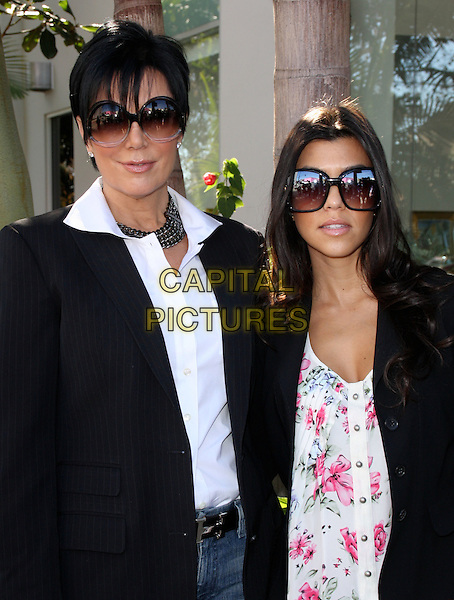 "KRIS JENNER & KOURTNEY KARDASHIAN.""Peta"" The Unveilling of Khloe Kardashian Cover For Peta Poster held On Melrose Avenue, Los Angeles, California, USA..December 10th, 2008.half length sunglasses shades jacket white pink floral print top mother mom mum daughter family shirt.CAP/ADM/KB.©Kevan Brooks/AdMedia/Capital Pictures."