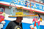BRIAN DILLON of Bay Ridge is wearing a large handmade Coney Island themed hat with a Wonder Wheel, Nathan's Famous, and red Parachute Jump ride, at the Fourth Annual History Day at Deno's Wonder Wheel Amusement Park and The Coney Island History Project, has family fun music, history, and entertainment at historic Coney Island. The theme of this year's festivities was the return of the Astroland Rocket.