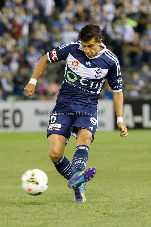 Daniel GEORGIEVSKI of the Victory passes the ball in the round seven match between Melbourne Victory and Brisbane Roar in the Australian Hyundai A-League 2014-15 season at Etihad Stadium, Melbourne, Australia.
