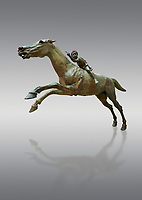 'Jockey of Artrmision' a Hellenistic bronze statue of a boy riding a horse. National Archaeological Museum Athens. Circa 140 BC. Cat No X 15177. Against grey<br /> <br /> Retrieved in pieces from a shipwreck of Cape Artemision in Euboea. The young jockey holds a rein in his left hand and a whip in his right. His face has a passionate expression with furrowas on his face. The pieces of the Bronze sculpture were reassembled in 1971.