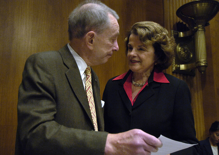 Chairman Arlen Specter , R-PA. talks with Dianne Feinstein before the start of the Senate Judiciary Committee on Immigration Reform..