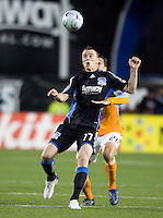 28 March 2009: Cam Weaver of Earthquakes tries to control the ball away from Geoff Cameron of Dynamo during the game at Buck Shaw Stadium in Santa Clara, California.  San Jose Earthquakes defeated Houston Dynamo, 3-2.