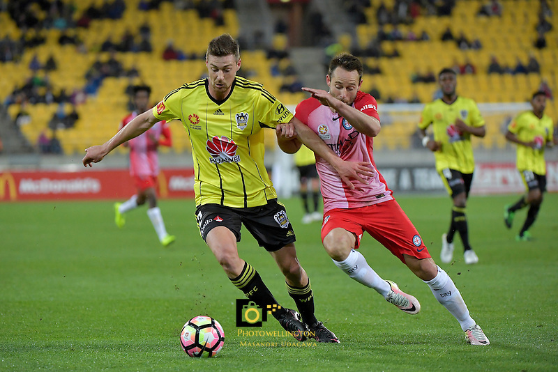 Wellington Phoenix&rsquo;  Jacob Tratt and Melbourne City FC's Joshua Rose in action during the A League - Wellington Phoenix v Melbourne City FC at Westpac Stadium, Wellington, New Zealand on Saturday 8 October 2016.<br /> Photo by Masanori Udagawa. <br /> www.photowellington.photoshelter.com.