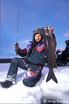 Ice fishing winter lake trout