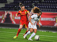 20131031 - ANTWERPEN , BELGIUM : Belgian Lorca Van De Putte (left) pictured in a duel with Portugese Matilde Fidalgo (right) during the female soccer match between Belgium and Portugal , on the fourth matchday in group 5 of the UEFA qualifying round to the FIFA Women World Cup in Canada 2015 at Het Kiel stadium , Antwerp . Thursday 31st October 2013. PHOTO DAVID CATRY