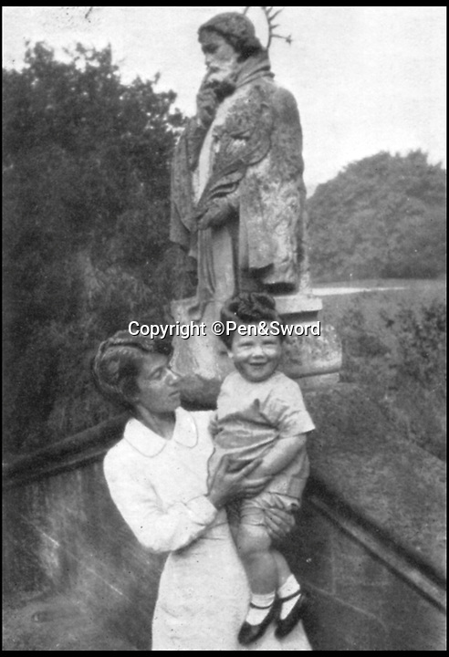 BNPS.co.uk (01202 558833)<br /> Pic: Pen&Sword/BNPS<br /> <br /> When this picture was taken in the garden at Glencot, Colin was eighteen months old.<br /> <br /> he remarkable story of a British hero double amputee pilot who took to the skies during the Second World War has come to light.<br /> <br /> Flight Lieutenant Colin Hodgkinson lost his legs in a horror crash in a Tiger Moth in May 1939 but went on to emulate Sir Douglas Bader and fly Spitfires in the Royal Air Force.<br /> <br /> He even endured a spell in the Great Escape prisoner of war camp after being shot down over France in 1943 but rejoined the RAF after being repatriated.<br /> <br /> The pair were the only two British double amputee pilots to fly during the war - yet while Bader, rightly, is a household name, Flt Lt Hodgkinson's exploits have been largely forgotten.<br /> <br /> This has prompted historian Mark Hillier to publish Flt Lt Hodgkinson's autobiography 60 years after it was penned which he hopes will shine some limelight on a 'special' man whose courage he says was every bit as great as Baders'.<br /> <br /> Best Foot Forward, by Colin Hodgkinson, is published by Pen & Sword.