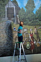 Touching up mural in Silverton, Oregon