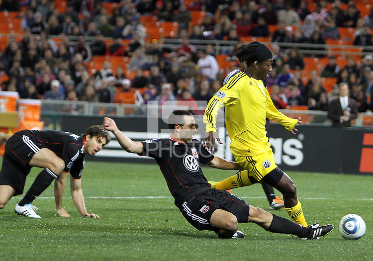 Jed Zayner#12 of D.C. United knocks the ball away from Andres Mendoza#10 of the Columbus Crew during the opening match of the 2011 season at RFK Stadium, in Washington D.C. on March 19 2011.D.C. United won 3-1.