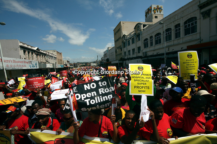 DURBAN - 7 March 2012 - Congress of South African Trade Unions march in protest against labour brokers and the controversial e-tolls that will see motorists tolled on greater Johannesburg's motorways..Picture: Giordano Stolley/Allied Picture Press/APP