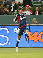 CARSON, CA – APRIL 30, 2011: Chivas USA defender Ante Jazic (13) passes the ball during the match between Chivas USA and New England Revolution at the Home Depot Center, April 30, 2011 in Carson, California. Final score Chivas USA 3, New England Revolution 0.