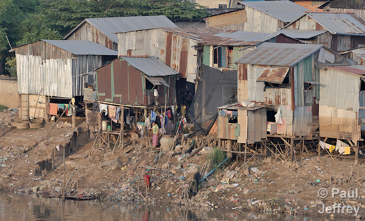 Housing along the shore of the Tonle Sap River in Phnom Penh, Cambodia.