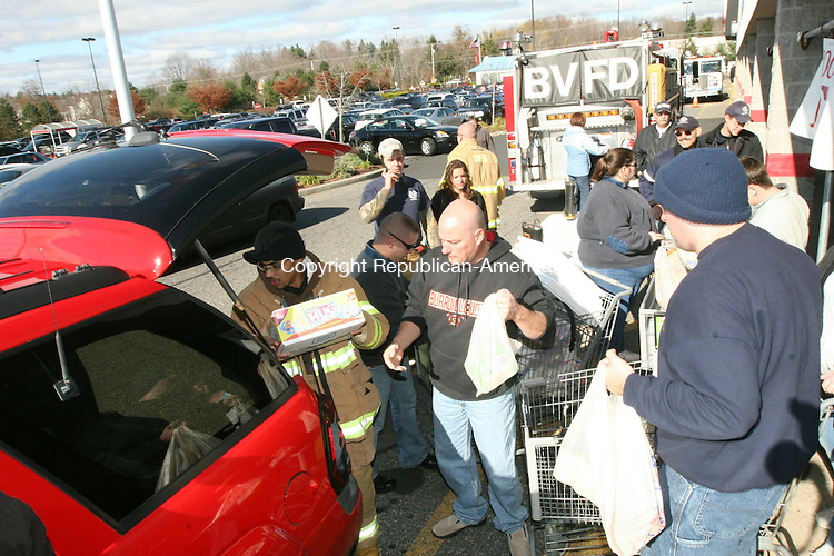 TORRINGTON, CT - 6 November, 2010 - 110610MO05 - Torrington's three volunteer fire departments joined forces Saturday to collect food for the FISH homeless shelter, filling several shopping carts with donated items at Price Chopper.  Jim Moore Republican-American.