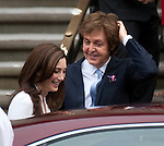 Paul McCartney wedding to Nancy Shevell at Westminster Registry Office in Marylebone Road, London.today 9.10.11.Macca shakes the confetti from his hair with some help from Nancy...Pic by Gavin Rodgers/Pixel 8000 Ltd
