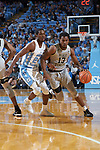 Bryant Crawford (13) of the Wake Forest Demon Deacons dribbles past Kenny Williams (24) of the North Carolina Tar Heels during first half action at the Dean Smith Center on December 30, 2017 in Chapel Hill, North Carolina.  The Tar Heels defeated the Demon Deacons 73-69.  (Brian Westerholt/Sports On Film)