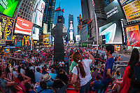 New York, NY - 11 July 2014 Tourists on the TKTS Red Steps in Times Square ©Stacy Walsh Rosenstock/Alamy