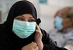 Palestinian kidney patients wash at dialysis unit in al-Shifa hospital in Gaza city on Dec 8,2009 while wearing protective masks as first deaths of A/H1N1were registered. Two Palestinian women have died of A/ H1N1 virus in Gaza Strip, the first deaths from the virus in the Israeli-blockaded enclave, a health official said Monday. Photo by Wissam Nassar