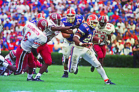 Fred Taylor (21) carries the ball, University of Florida Gators defeat the University of South Carolina Gamecocks 48-17 at Ben Hill Griffin Stadium, Florida Field, Gainseville, Florida, November 12, 1994 . (Photo by Brian Cleary/www.bcpix.com)