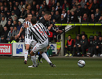 Lee Mair catches Gary Hooper late in the St Mirren v Celtic Clydesdale Bank Scottish Premier League match played at St Mirren Park, Paisley on 20.10.12.