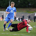 City Keeper Andrew Stobie saves at the feet of Queen of the South's Gavin Reilly ...