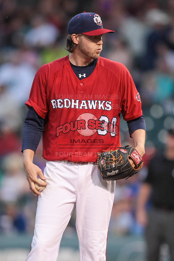Ross Seaton (30) of the Oklahoma City RedHawks getting ready to pitch during the Pacific Coast League game against the Round Rock Express at Chickashaw Bricktown Ballpark on June 14, 2013 in Oklahoma City ,Oklahoma.  (William Purnell/Four Seam Images)