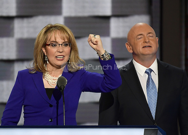 Former United States Representative Gabby Giffords (Democrat of Arizona) makes remarks during the third session of the 2016 Democratic National Convention at the Wells Fargo Center in Philadelphia, Pennsylvania on Wednesday, July 27, 2016.  Her husband Mark Kelly looks on from right.<br /> Credit: Ron Sachs / CNP/MediaPunch<br /> (RESTRICTION: NO New York or New Jersey Newspapers or newspapers within a 75 mile radius of New York City)
