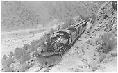 Elevated trackside view of K-28 #473 with northbound Chili Line train south of Embudo.<br /> D&amp;RGW  s. of Embudo, NM  Taken by Perry, Otto C. - 3/21/1941