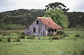 Serra do Caracol, Rio Grande do Sul, Brazil. Dilapidated rural wooden shack in the middle of the countryside.