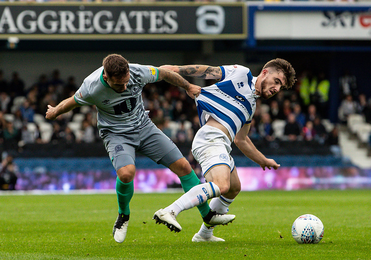 Blackburn Rovers' Adam Armstrong competing with Queens Park Rangers' Ryan Manning (right) <br /> <br /> Photographer Andrew Kearns/CameraSport<br /> <br /> The EFL Sky Bet Championship - Queens Park Rangers v Blackburn Rovers - Saturday 5th October 2019 - Loftus Road - London<br /> <br /> World Copyright © 2019 CameraSport. All rights reserved. 43 Linden Ave. Countesthorpe. Leicester. England. LE8 5PG - Tel: +44 (0) 116 277 4147 - admin@camerasport.com - www.camerasport.com