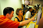 PEOPLE USING COMPUTERS IN EASYEVERYTHING INTERNET CAFE, LONDON, 1999