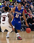 OMAHA, NE - January 10, 2015 -- South Dakota State's George Marshall (11) looks past the defense of Devin Patterson (3) of UNO to his teammates during the first half of their game Saturday evening at the Ralston Arena in Ralston, NE. (Photo By Ty Carlson / DakotaPress)
